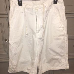 Men's Akademiks brand white shorts.